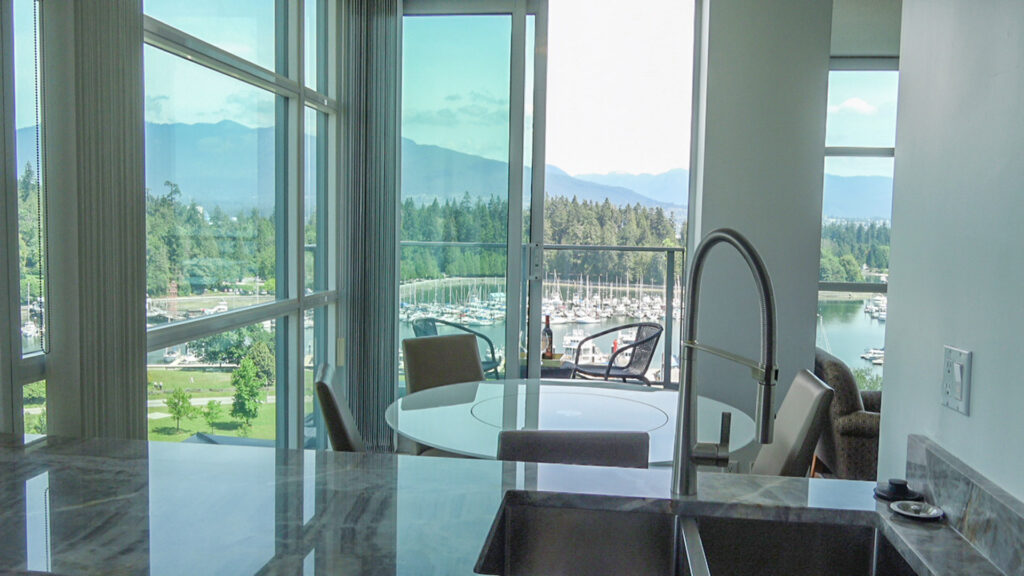 Presidential Suites Kitchen And Dining Room With Coal Harbour Views